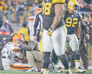 Trainers tend to Cleveland Browns quarterback Colt McCoy (12) after he was hit by Pittsburgh Steelers outside
