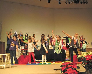 "Children perform Christmas musical: Old North Church, 7105 Herbert Road, Canfield, will be the setting for ""ihope Christmas"" starting at 6 p.m. Sunday. Krista Hosler will direct the musical that presents the Christmas message with both song and drama. Shown at rehearsal are some of the 35 children in the performance. The event is free, and refreshments will follow."