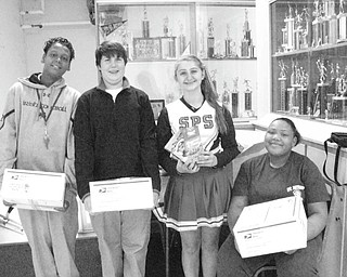 "Three cheers for Hubbard students: Members of the Builders Club at St. Patrick School in Hubbard have adopted three soldiers this holiday season. The club is a service organization for junior high students who raise funds to help members of the community as well as fellow students. Club members selected servicemen listed in The Vindicator's ""Operation Holiday Cheer"" section, choosing one each from Youngstown, Campbell and Hubbard, the three communities that send students to the school. Various items will be sent to the soldiers throughout the school year. Club members from left to right: Devin Harden, Jack Sebest, Michaela Huber and Kayla Carter."