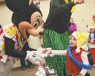 Michael Clark, 2, of Canfield meets Minnie Mouse, one of the stars of Disney On Ice, which will be at the Covelli Centre through Sunday. Mickey and Minnie Mouse visited with children Thursday at the Boardman Library on Glenwood Avenue.