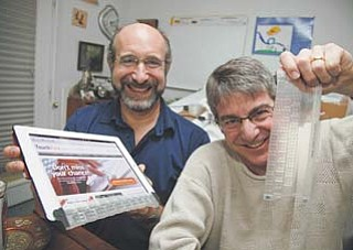 Steven Isaac, left, and Brad Melmon, director of product development of TouchFire, display the silicone overlay that goes on top of the virtual keyboard of an Apple iPad.