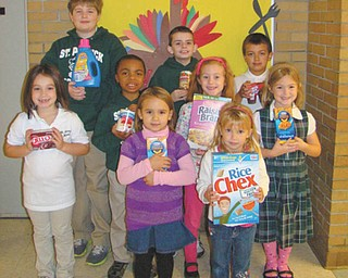 Students collect for the needy: St. Patrick School in Hubbard recently had a food drive. Hoping to make the holidays a little easier for those in need, students in each classroom collected specific items that included canned and boxed food, household cleaning supplies and paper products. They filled more than 15 boxes and bags, which were donated to the St. Vincent de Paul Society for distribution. Among the students who participated are, left to right, front row: Mollie Greco, Nora DePizzo and Lauren Murcko; middle row: Matt Jacobs, Elizabeth Sandy and Elaina Matricardi; and back row: Daniel Robinson, Cooper Muccio and Hayden Lopez.