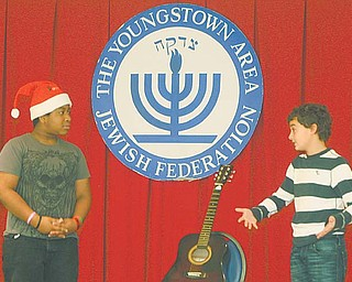 Akiva Academy sixth-grader Ben Shapiro, 12, right, suggests to Santa Claus, played by seventh-grader Eric Allen, 12, that he attend a Hanukkah program to learn about the meaning of the Jewish observance.