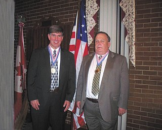 Hall of Fame inductees: The annual Hall of Fame Banquet of the Greater Youngstown Area Chapter of the Knights of Columbus took place recently at St. George Lodge on Vestal Road in Youngstown. Among the honorees were two members of Girard Council 2935. Tom Gaul, left, was inducted for the year 2011. Gaul is president of the council home company, a trustee in the Third and Fourth degrees and caretaker of the council hall; handles hall rentals; and performs with the honor guard. Mike Norton, right, was inducted for the year 2011 and chosen as class honoree in the Third Degree. Norton is grand knight of Council 2935, membership and veterans director, pilot for the Fourth degree, recording secretary for the home company and vice president of the Greater Youngstown Area Chapter; performs with the honor guard; and serves on the board of directors of the President Charity Foundation.
