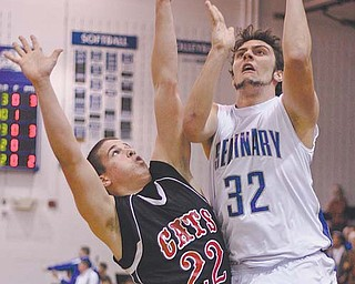 Poland's John Bannon (32) shoots over Struthers' Austin Grewe during Tuesday's game in Poland.