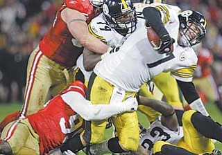 Pittsburgh Steelers quarterback Ben Roethlisberger (7) is sacked by San Francisco 49ers linebacker Aldon Smith (99) during the fourth quarter of a game in San Francisco on Monday.
