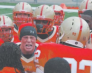 A 2008 graduate of Ursuline High School, Nick McGahagan fires up his Seton Hill teammates before a game this season. The Austintown native set school records in tackles and was named a Division II All-American with 