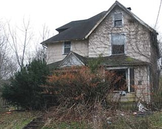 Officials found five dogs and a dogfighting setup inside this abandoned West Myrtle Avenue home on Youngstown's South Side earlier this week. Three of the dogs are in the care of the county dog warden, but two were missing when officials went to remove