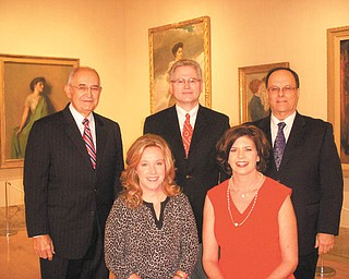 Standing, left to right, are 2012 Heart Ball honorees Dr. John O. Vlad, Dr. Donald J. Tamulonis Jr. and Dr. Larry A. Woods. Seated, left to right, are Rachel Barber of VEC Inc., event chairwoman, and Regina Rebhan of the Regina M. Rebhan Family Foundation and Warren Fabricating and Machining Corp., sponsors of the event.
