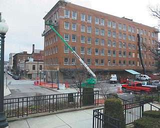 Construction work progresses on the Erie Terminal building, a $9 million, 65-person residential complex that will be the latest, biggest brick in a critical bridge between downtown and the Youngstown State University campus. Dominic Marchionda and his wife, Jackie, are spearheading the project.