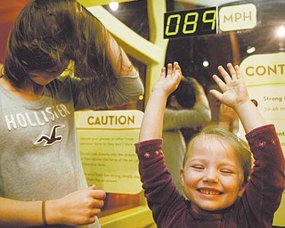 Mary Gomez, 10, of Canfi eld, left, and her cousin, Heidi Bartels, 4, of Salem, experience hurricane-force winds in a wind tunnel at OH WOW! The Roger & Gloria Jones Children's Center for Science and Technology on West Federal Street downtown. The center, along with the Youngstown Business Incubator, hosted an inaugural Y-Town Tech Tour on Monday.