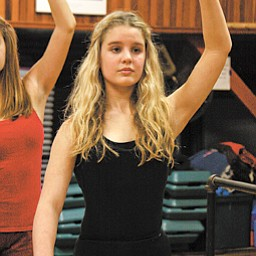 McCallen Warrick of Boardman practices her dance moves in preparation for her class's performance at the Orange Bowl. After weeks of practice, the girls will leave for Florida on New Year's Day.