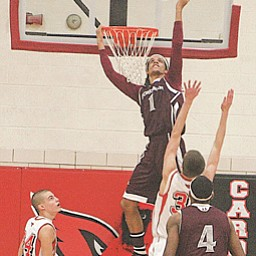 Boardman's Dayne Hammond (1) goes for a slam during Tuesday's game at Canfield.