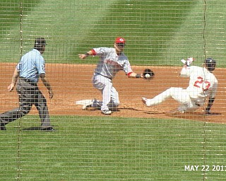 Michael Brantley of the Cleveland Indians is sliding safely into second base before the fielder for the Cincinnati Reds drops the ball on May 22, 2011, in this photo taken by Shelly Toth of Austintown.