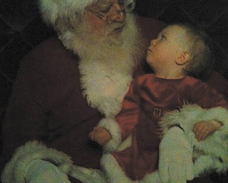 This is Olivia Bugzavich's first visit with Santa.