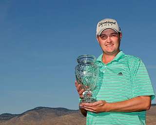 Jason Kokrak with his trophy after winning the Albertsons Boise Open, presented by Kraft, ending September 18, 2011.