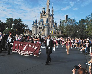 """The Boardman Spartans Marching Band traveled to Disney Theme Parks from Dec. 27 to Jan. 1. Under the direction of Thomas Ruggieri, director of bands, and Michael Shevok, assistant director, the band participated in """"Mickey's Once Upon A Christmastime"""" parade at Disney's Magic Kingdom. Leading the band were field conductors Tony Colella, right, and Carmen Moradian, left. While there, the band's Jazz Ensemble 1, under the direction of Ruggieri, also performed at Downtown Disney's Waterside Stage."""