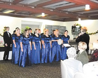 American Association of University Women, Warren-Trumbull County Branch, were treated recently to an evening of holiday entertainment. Members of Lakeview Madrigal Singers, above, under the direction of Bonnie Chronister, performed several selections. The next meeting of AAUW will be Feb. 6. For information on becoming a member or attending a meeting call 330-898-3696.