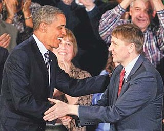 President Barack Obama shakes hands with Richard Cordray in Shaker Heights, Ohio. In a defiant display of executive power, Obama on Wednesday bucked GOP opposition and appointed Cordray as the nation's chief consumer watchdog.