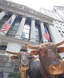 A pair of bulls is displayed in front of the New York Stock Exchange on Thursday to promote the Professional Bull Riders annual event at Madison Square Garden. Stocks steadily gained ground Thursday after falling sharply at the open. Investors weighed renewed concern about Europe against the latest encouraging report about the U.S. job market.