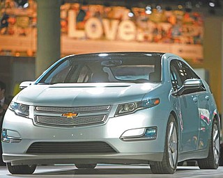 The 2011 Chevrolet Volt debuts at the Los Angeles Auto Show in Los Angeles. General Motors will strengthen the structure around the batteries in its Volt electric cars to keep them safe during crashes, a person briefed on the matter said Thursday.