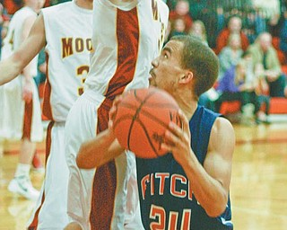 Fitch's Nate Blair (24) looks for room as Mooney's Doug Caputo closes in under the Mooney basket during Tuesday's game at Mooney. The Falcons won, 47-46.