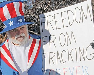 Trumbull County resident Werner Lange dressed as Uncle Sam showed his feelings on fracking.