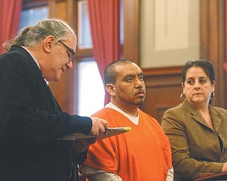 State-certifi ed English-Spanish interpreter John P. Shaklee, left, interprets for Victor Manuel Galindo-Barjas, a native Spanishspeaker from Mexico, during a court hearing in which Barjas pleaded guilty to drunken driving and two counts of aggravated vehicular assault. At right is Barjas' lawyer, Miriam Ocasio. Costs for interpreters have been low. A5.