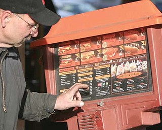 Tony Torisk of Struthers checks out the outdoor menu board.