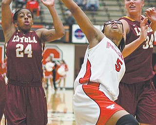 Youngstown State's Kenya Middlebrooks (5) fi ghts for a loose ball against Loyola defenders Ayrealle Beavers (24) and Abby Skube (34) during the fi rst half of their basketball game Thursday at YSU's Beeghly Center. The Penguins came up short against the Ramblers, losing 82-77.
