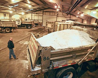 Gary Setz, highway maintenance supervisor with the Mahoning County engineer's office, inspects the salt-truck fleet Thursday as it stands ready in the garage to keep county roads safe for motorists as the predicted snow 