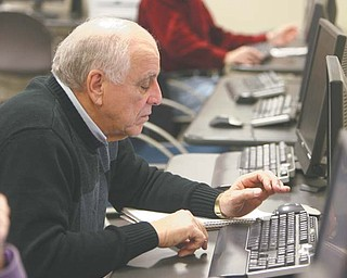 Auggie Ruggiero of Austintown checks out some websites during a computer class at the Austintown Senior Center. The class meets weekly and is taught by volunteers from the Austintown Local School District. Barb Kliner, district grant coordinator, met with seniors Tuesday to discuss helpful websites such as AARP.com, RetailMeNot.com and Amazon.com.