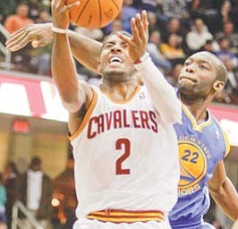 Cleveland Cavaliers' Kyrie Irving (2) shoots in front Golden State Warriors' Charles Jenkins in the second quarter of a game Tuesday in Cleveland.