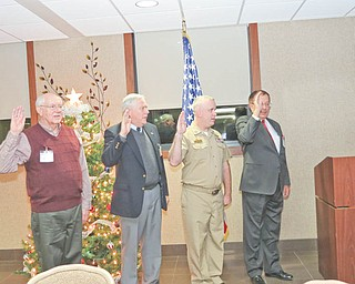 New officers of the Mahoning and Shenango Valleys Chapter of Military Officers Association of America take their oath of office in the newly formed chapter headquarters. From left to right are retired Chief Warrant Officer 3rd Class Don Oglesby, secretary/treasurer; retired Lt. Col. Donald Rasile, second vice president; Lt. John Holzer, first vice president; and retired Col. Walter Duzzny, president.