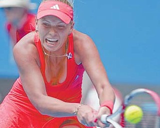 Caroline Wozniacki returns a shot to Anna Tatishvili during the Australian Open. Wozniacki is getting advice from her boyfriend, golf star Rory McIlroy, on handling pressure at major tournaments.