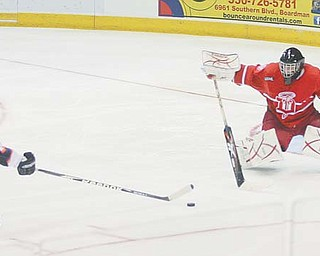 J.T. Stenglein, left, of the Youngstown Phantoms had three points for the team in last weekend's games against Team USA.