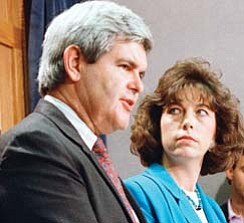 In this photo from April 1989, Newt Gingrich and his second wife, Marianne, a Leetonia native, discuss a book they wrote.