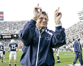 In this file photo from Nov. 5, 2005,  Penn State football coach Joe Paterno acknowledges the crowd during warm-ups before the NCAA college football game against Wisconsin in State College, Pa.  Paterno, the longtime Penn State coach who won more games than anyone else in major college football but was fired amid a child sex abuse scandal that scarred his reputation for winning with integrity, died Sunday, Jan. 22, 2012. He was 85.  (AP Photo/Carolyn Kaster, File)