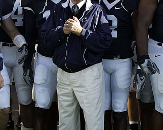 Penn State football coach Joe Paterno stands with his team before they take the field for a football game against Wisconsin in State College, Pa., in this Oct. 13, 2007, file photo. Penn State won 38-7. Paterno is being paid about a half-million dollars a year, state officials said Thursday, Nov. 29, 2007, ending one of the most closely guarded secrets of college sports in Pennsylvania. (AP Photo/Carolyn Kaster)
