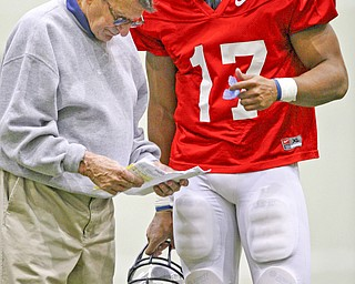 Penn State coach Joe Paterno, left,  talks with quarterback Daryll Clark during a football practice in State College, Pa., Saturday, March 29, 2008. (AP Photo/Carolyn Kaster)