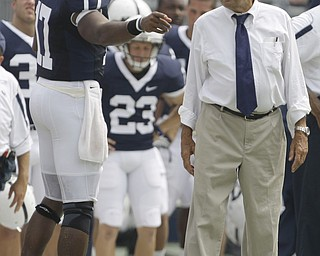 Penn State head coach Joe Paterno, right, quarterback Daryll Clark talk on the sideline during the first half of their college football game against Coastal Carolina Saturday, Aug. 30, 2008 at Beaver Stadium in State College, Pa. The scoreboard showed a smashing success for Penn State's offense, but quarterbacks coach Jay Paterno sought to temper some of the enthusiasm following the season-opening, 66-10 blowout. (AP Photo/Carolyn Kaster)