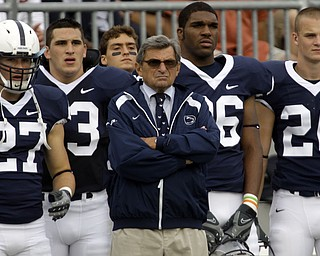 In this Sept. 6, 2008 file photo, Penn State head coach Joe Paterno, center,  stands with players, from left, Jacob Fragnano, Chris Colasanti,  Mark Wedderburn,  and J.D. Mason as they watch the game for the sideline during the first half of  their NCAA college football game against Oregon State at Beaver Stadium in State College, Pa. After skating through its nonconference schedule, No. 12 Penn State could gain some respect with a win Saturday night in its Big Ten opener against No. 22 Illinois.  (AP Photo/Carolyn Kaster, File)