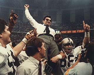 In this Jan. 1, 1983 file photo, Penn State football coach Joe Paterno celebrates as he is carried off the field after a 27-23 victory against Georgia in the Sugar Bowl,  to claim the national championship, at the Superdome in New Orleans. Paterno say he plans to retire at the end of the season, his long and illustrious career brought down because he failed to do all he could about an allegation of child sex abuse against a former assistant.  (AP Photo/File)