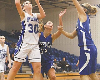 Poland's Maura Bobby (30) drives to the hoop between Lakeview defenders Jamie Sentner (34) and Calli