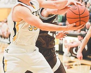 Crestview's Robert Logan, left, wrestles the ball away from East Palestine's Zakary Brockman during the second period of their game Tuesday in Crestview.