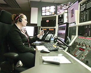 Boardman dispatcher Lauren Bruno, above, directs emergency calls to police and fire Wednesday. The process of hiring dispatchers has been bumped up from September 2012 to now.