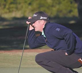 Warren JFK graduate Jason Kokrak lines up a putt during the Nationwide Tour Championship in Charleston,
