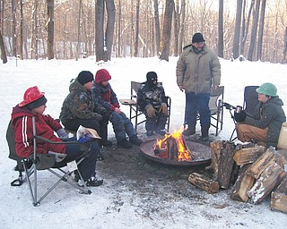 Boy Scout Troop 101 takes a break at the Klondike Derby at Camp Stambaugh. Photo by Bob Granchie, troop chaplain.