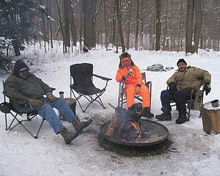At the Boy Scouts' Klondike Derby at Camp Stambaugh, Dale Gottberg, left, Bobby Granchie and Scoutmaster Jeff Wormley of Troop 101 in Struthers take a break.