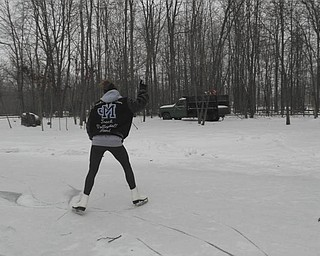 Susie McKinney of North Jackson was 17 when she skated up and down her driveway after an ice storm in February of 2011. Photo sent in by her mom, Mary Sue McKinney.